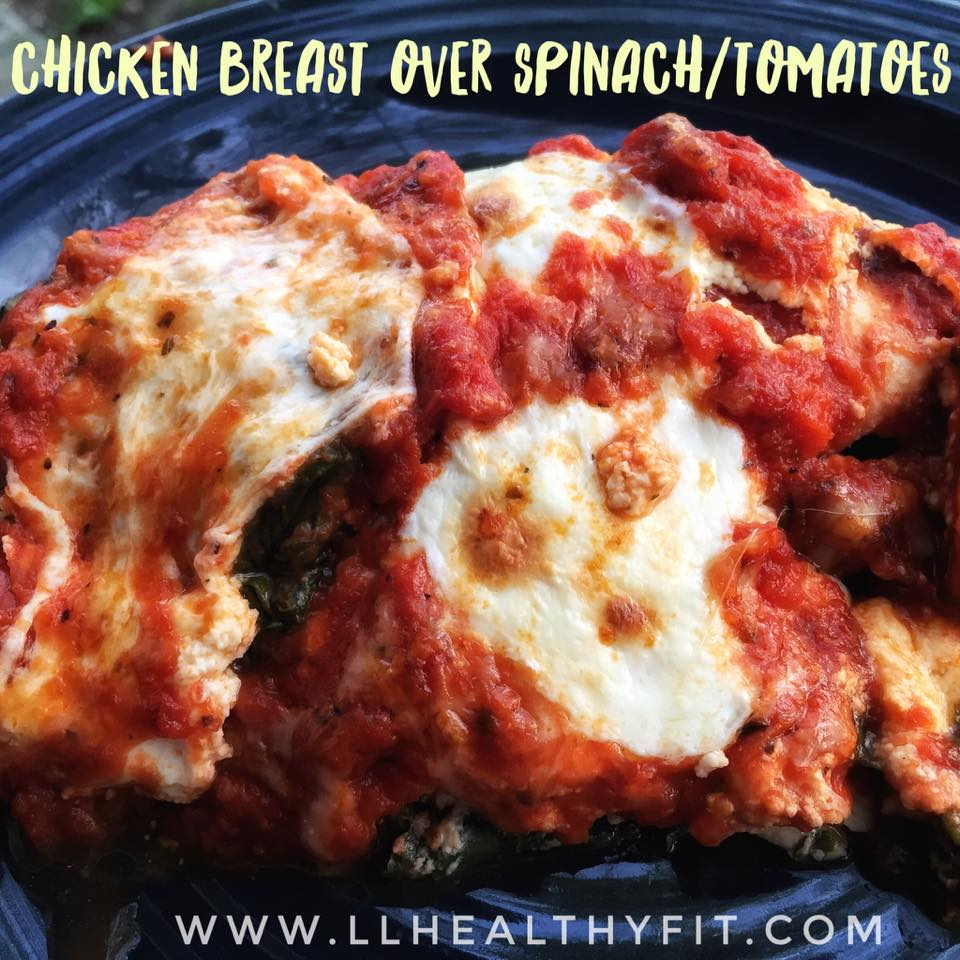 Chicken Breast over spinach and tomatoes